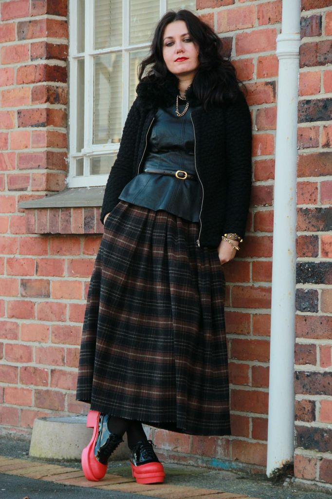 Leather top, long skirt, red creeper